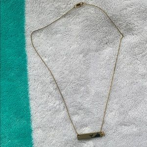 Gold with black whale necklace